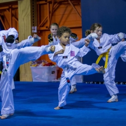 tkd - kids 7plus group kicking.jpg