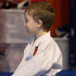 tkd - kids explorers take a knee.jpg
